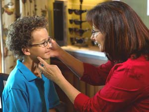 Child with eye doctor