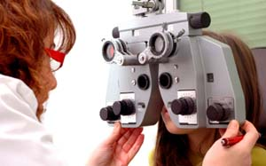 Eye doctor examining patient